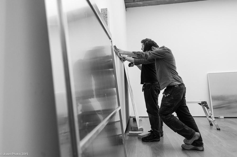 Technicians prepare alarge aluminium print