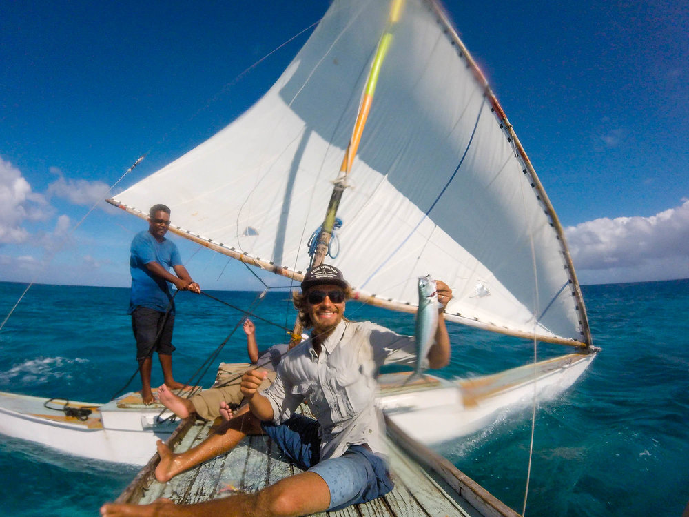 Fishing on a traditional Marshallese sailing canoe in the Marshall Islands.