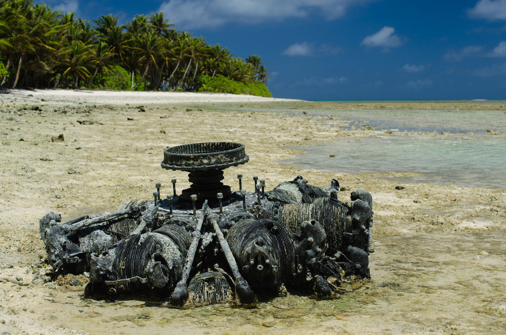 An airplane engine lies in the tidal flats beside the Taroa Island, the most easterly Japanese airfield base during World War II