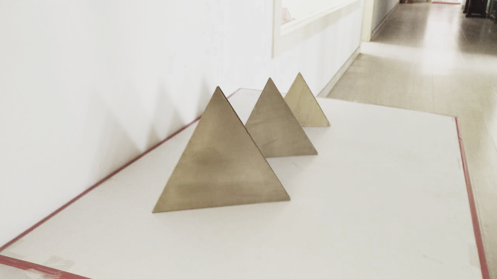 brass pyramids.png