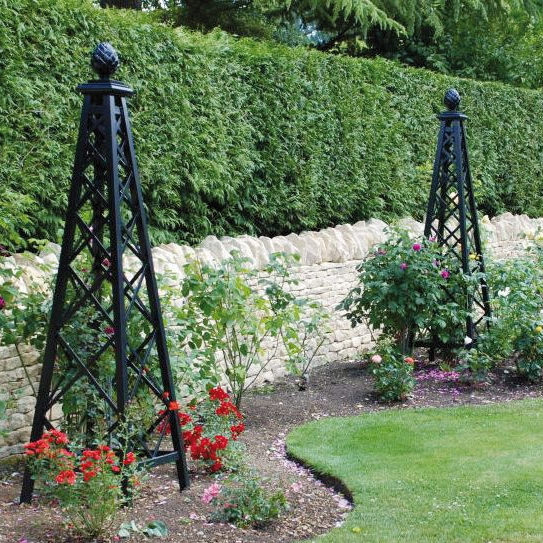 Obelisk - Add points of interest to your border with a garden obelisk. The tapering pillar shape of an obelisk, typically made of metal, looks stunning alone or supporting climbers. Obelisks punctuate lower plantings, adding much-needed height.