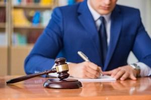 bigstock-Handsome-judge-with-gavel-sitt-169115945.jpg