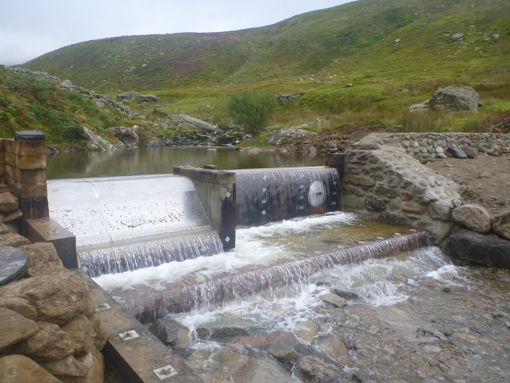 Hydro Electric - Planning and licensing, installation, commissioning of small and medium scale hydroelectric systems throughout Wales. Currently contracted to perform the operation and maintenance (O&M) on several 300kW-scale hydro systems and call-out to troubleshoot and repair numerous smaller systems. Photo is of the weir and intake at Anafon hydro in North Wales.