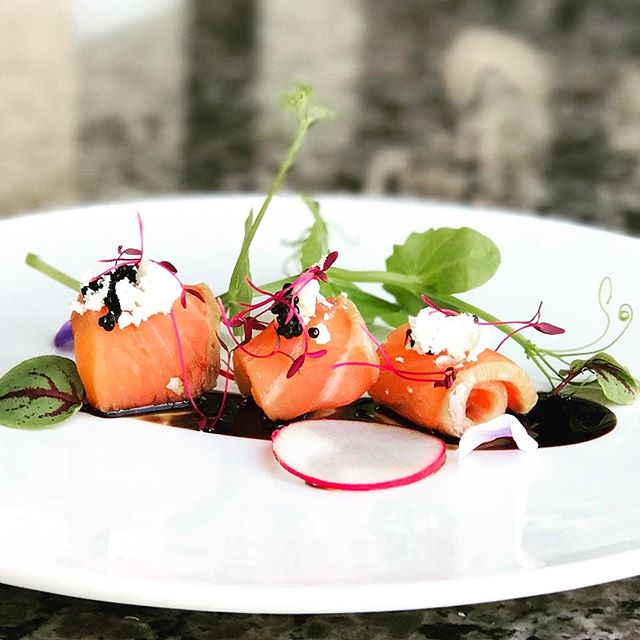 A fresh new special smoked in-house that you have to try!  Rolled Smoked Salmon with goat cheese, bacon fat powder, caviar and a balsamic reduction.