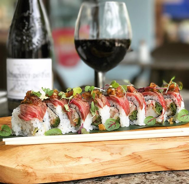 From the land and sea... Surf & Turf Roll • Robata-grilled lobster tail and tempura shishito pepper topped with a layer of yuzu ponzu marinated A4 Wagyu beef, garnished with oriental salsa, Himalayan salt, and micro cilantro #UmiWinterPark #surfandturf #wagyu #lobster #bestrollever