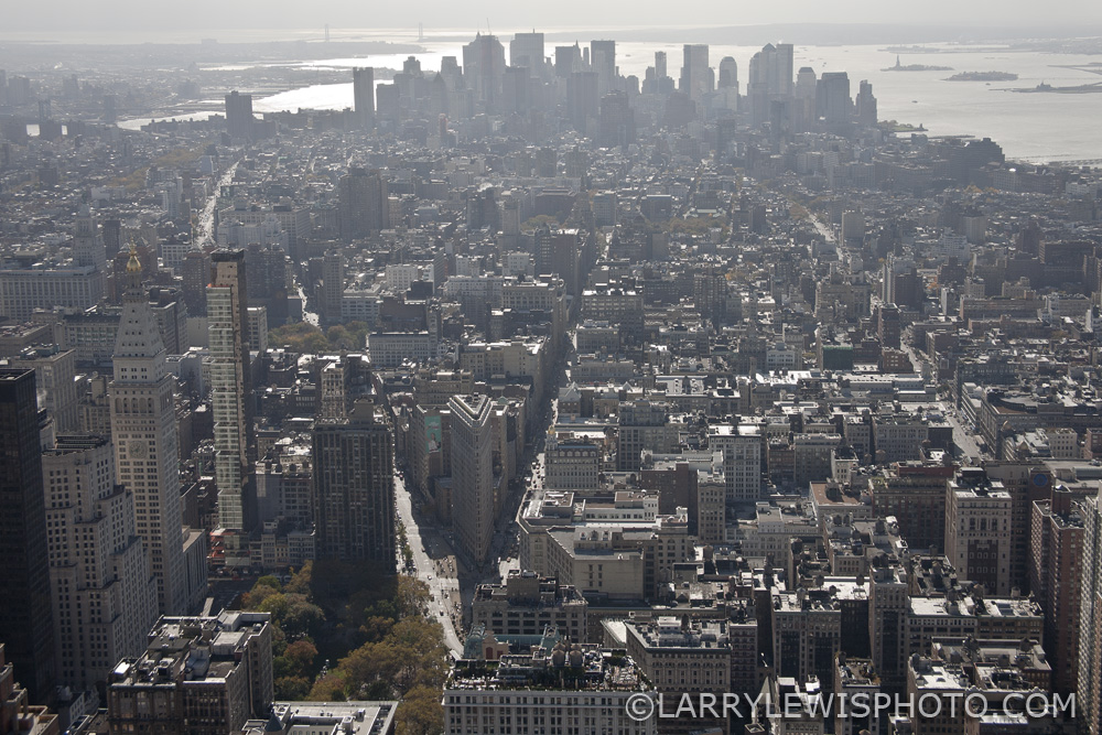 The New York Flatiron, lower left centre of the image, photographed from the Empire State Building in 2009.