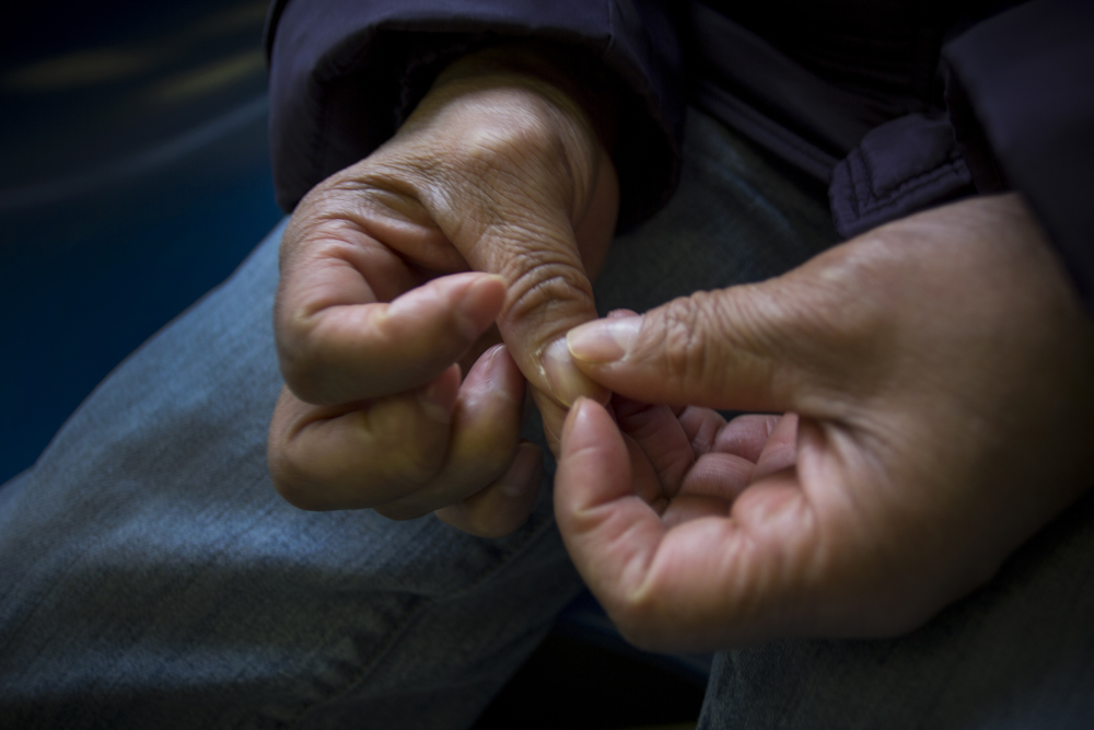 Campos examines her hands, marked by years of working as a housekeeper, seamstress and cook.