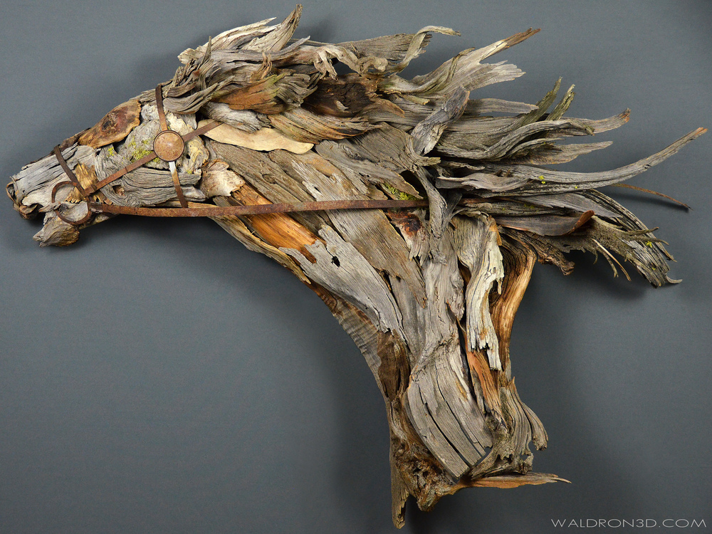 "WALDRON 3D | SCULPTURAL EXPRESSIONS - ""DRIVEN"" THIS WALL HANGING ASSEMBLAGE SCULPTURE OF A HORSE BUST IS ROUGHLY 5FT. WIDE X 3FT. 6IN. TALL X 18IN. DEEP. CONSTRUCTED FROM RECLAIMED PIECES OF WEATHERED METAL AND FORAGED, WEATHERED PIECES OF HIGH DESERT WOOD; SUCH AS MANZANITA, JUNIPER, SAGE, AND PINE."