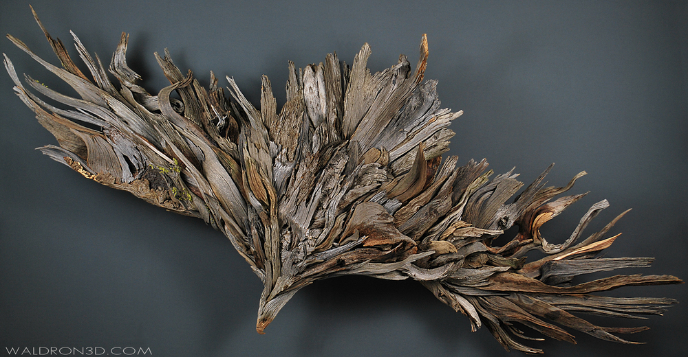 "WALDRON 3D | SCULPTURAL EXPRESSIONS - ""BOUNDLESS"" A WALL HANGING ASSEMBLAGE SCULPTURE OF AN EAGLE IN FLIGHT. 9FT. 6IN. WIDE X 4FT. 9 IN. TALL X 14IN. DEEP. CONSTRUCTED AND CARVED FROM FORAGED, WEATHERED PIECES OF HIGH DESERT WOOD; SUCH AS MANZANITA, JUNIPER, SAGE, AND PINE."
