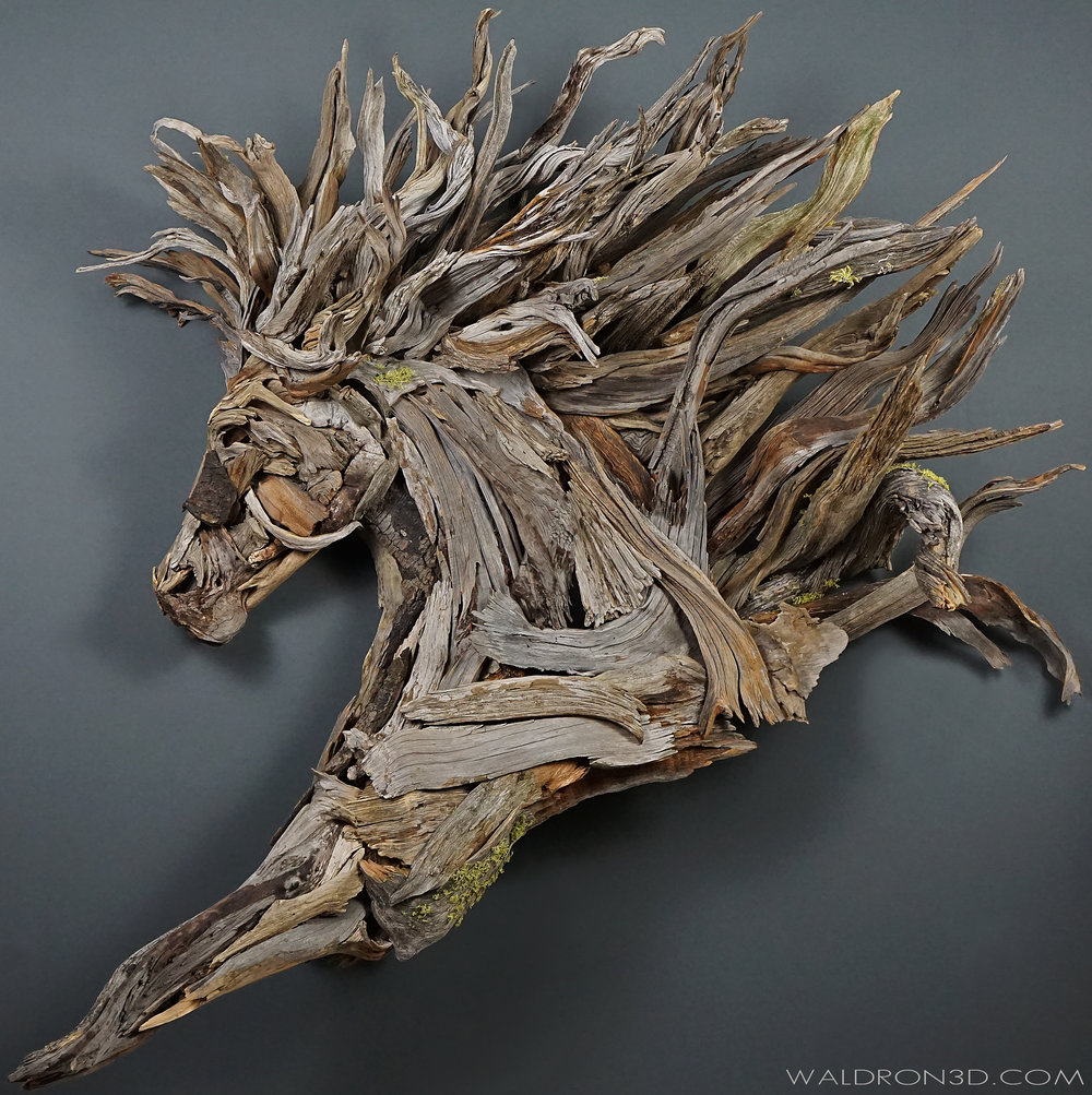 "WALDRON 3D | SCULPTURAL EXPRESSIONS - ""ZEALOUS"" THIS WALL HANGING ASSEMBLAGE SCULPTURE OF A REARING HORSE IS ROUGHLY 5FT. 6IN. WIDE X 5FT. 6IN. TALL X 28IN. DEEP. CONSTRUCTED FROM FORAGED, WEATHERED PIECES OF HIGH DESERT WOOD; SUCH AS JUNIPER, PINE, MANZANITA AND SAGE."