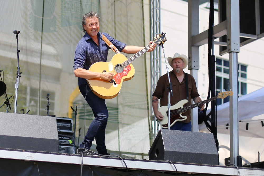 Mark Collie performing outside for free as part of the CMA's