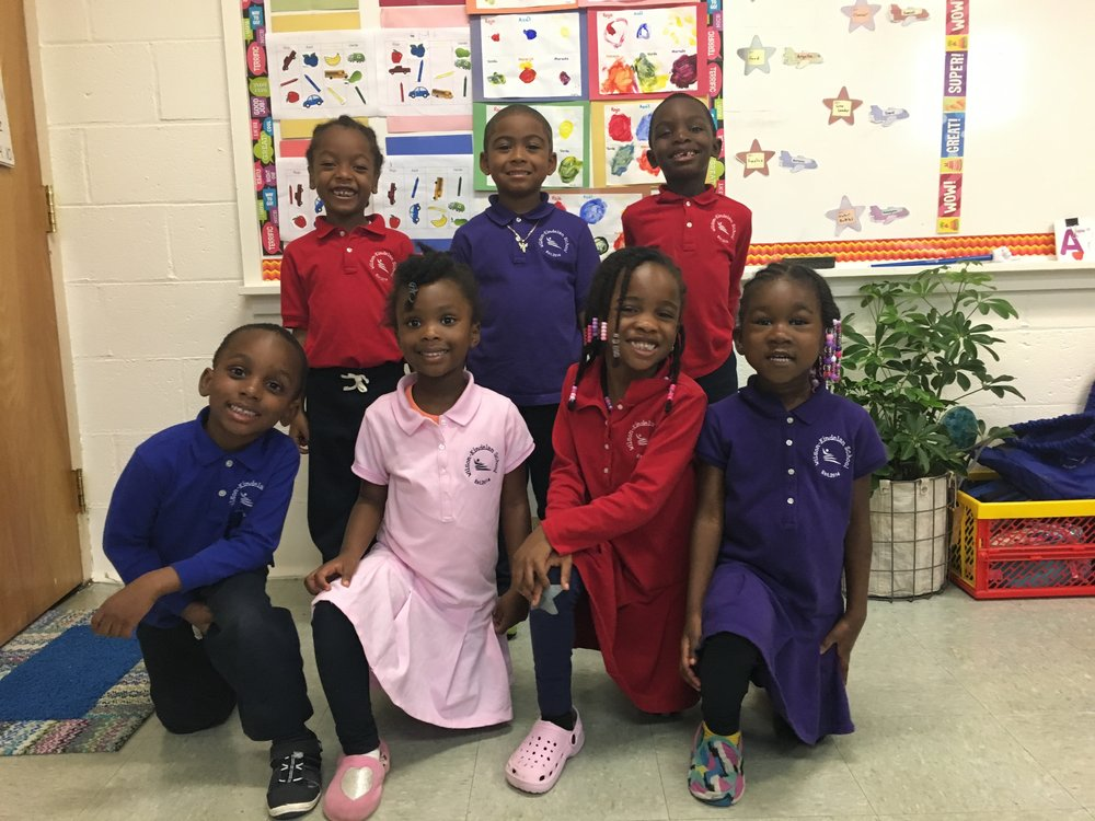 WKS Class Pictures are on their way! The students beamed their beautiful smiles for a group photo. In addition to a whole class pictures, students found their favorite spots around the classroom to take individual pictures.