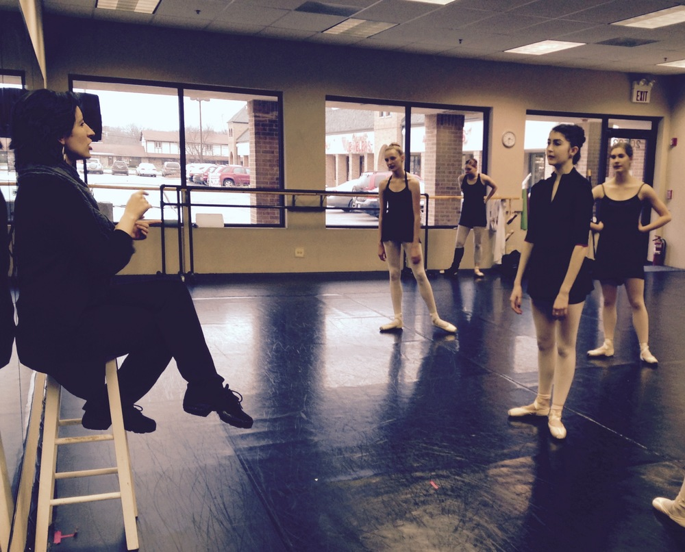 Ballet 5:8 Artistic Director Julianna Slager gives corrections to dancers after a rehearsal run of Beyond the Nutcracker