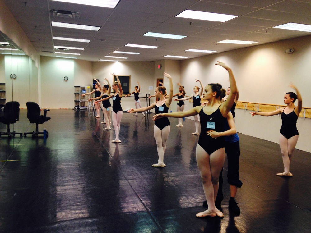 Ballet 5:8 Ballet Mistress Mrs. Lauren Ader-Cumpston gives a correction during Summer Intensive 2015.