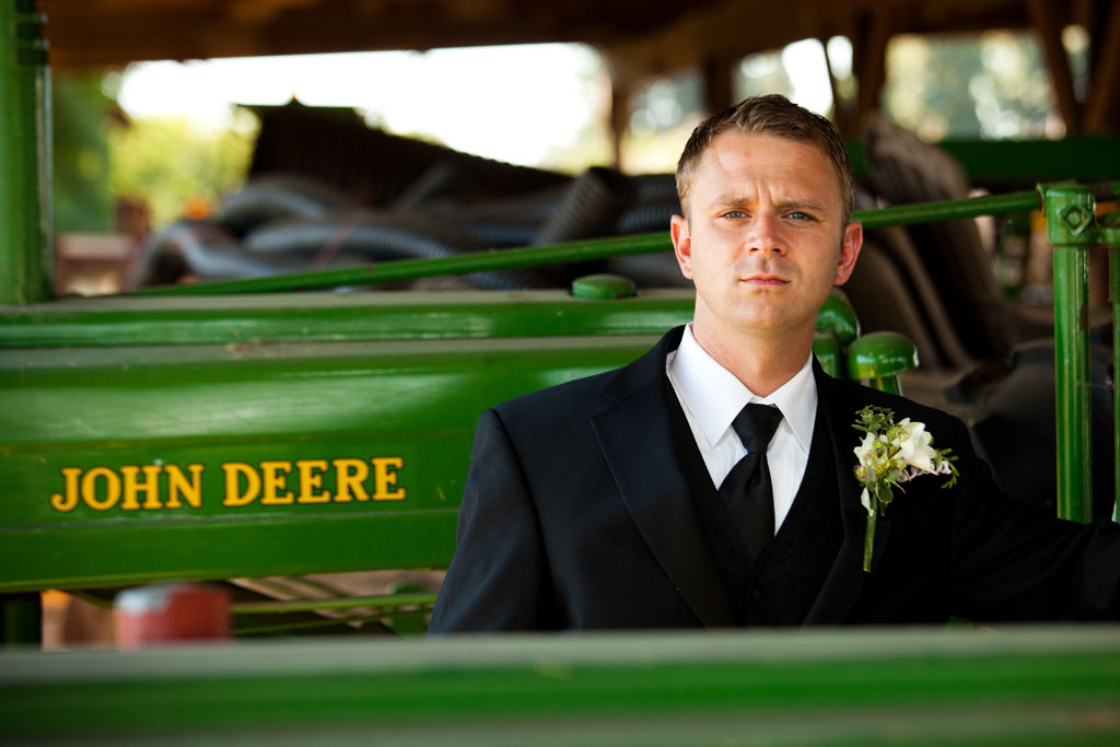 Groom with a John Deere tractor