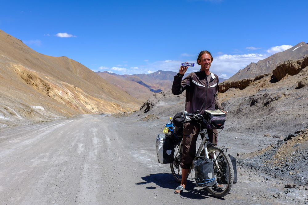 Sharing a  Dali Bar  with another cyclist on the Ak-Baital pass