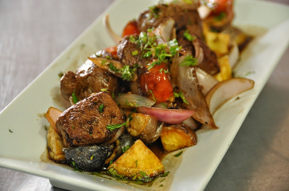 Llomo Saltado with alpaca and Andean potatoes