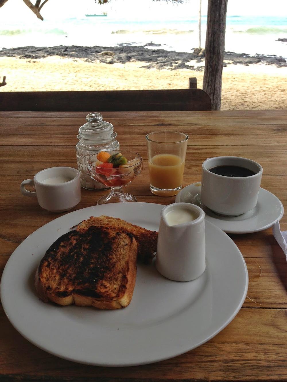 On the menu this morning: French toast, fruit cup, yogurt and honey, fresh papaya juice, and coffee. Delish.