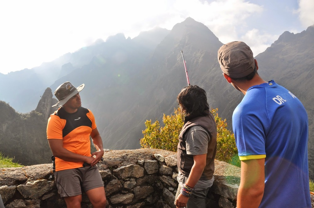 "Our guide, William, pointing out ""Dead Woman's Pass"", which we had crossed the previous day. Damn, we were high!"