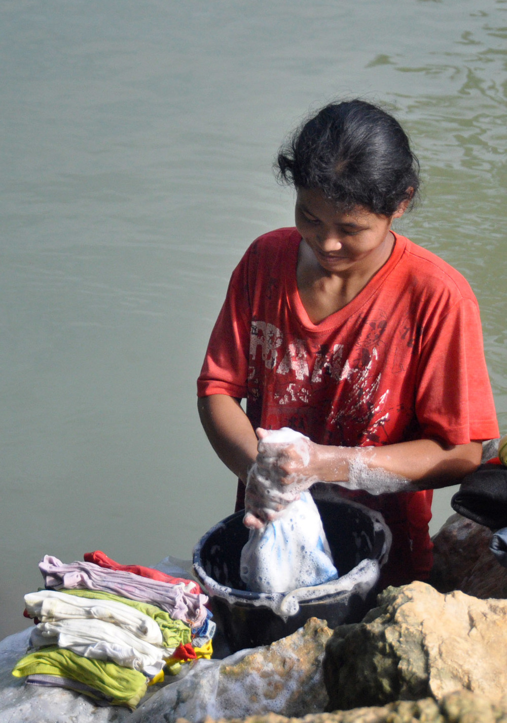 Philippines woman washing clothes