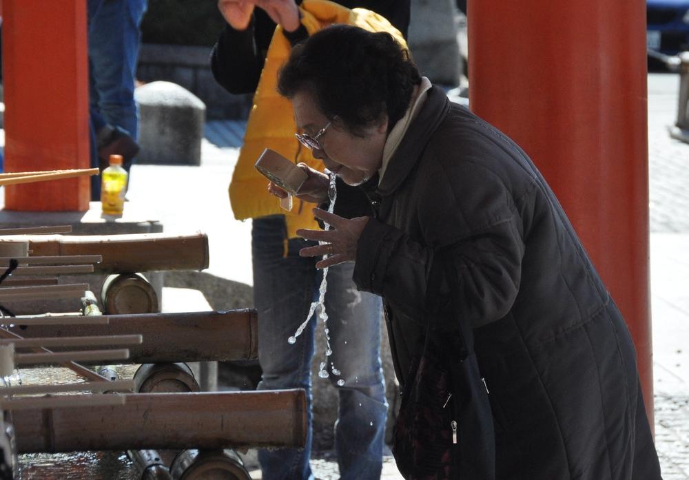 Fushimi Inari Shrine Japan Orange Gates Woman spit