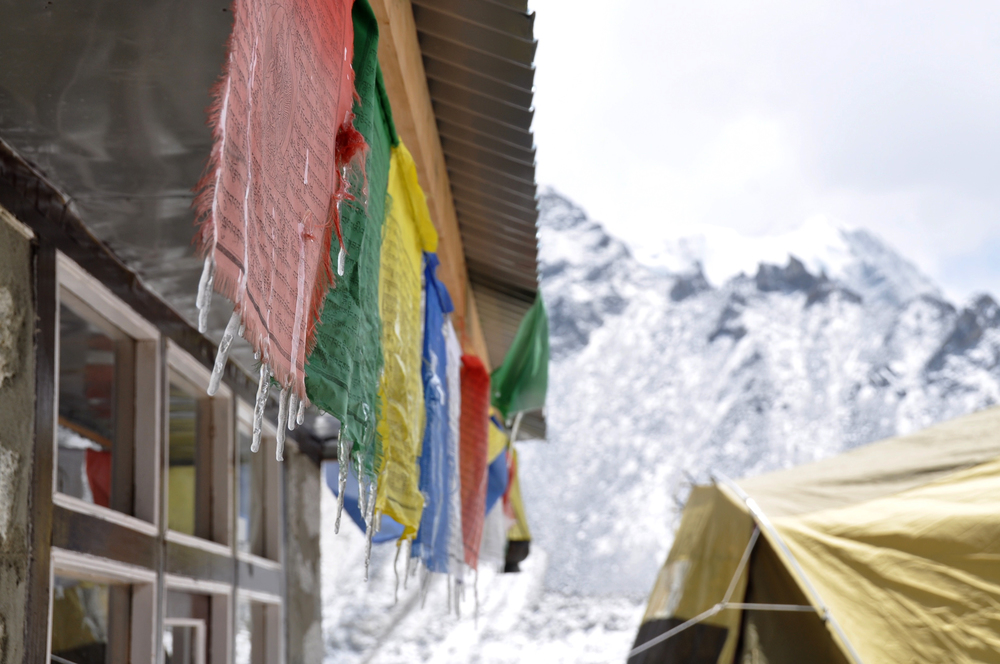 Everest Base Camp trek prayer flags icicles