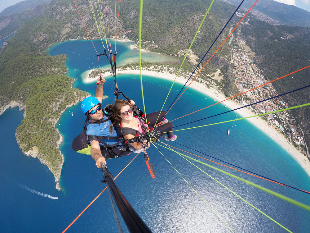 Soar over the stunning waters in Oludeniz while paragliding!