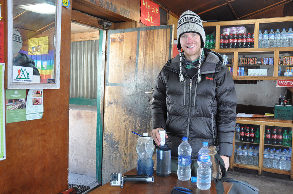 This is Ben sterilizing all our water during our trek to Everest Base Camp. (His puffy cheek is the result of a tooth infection - poor guy!)