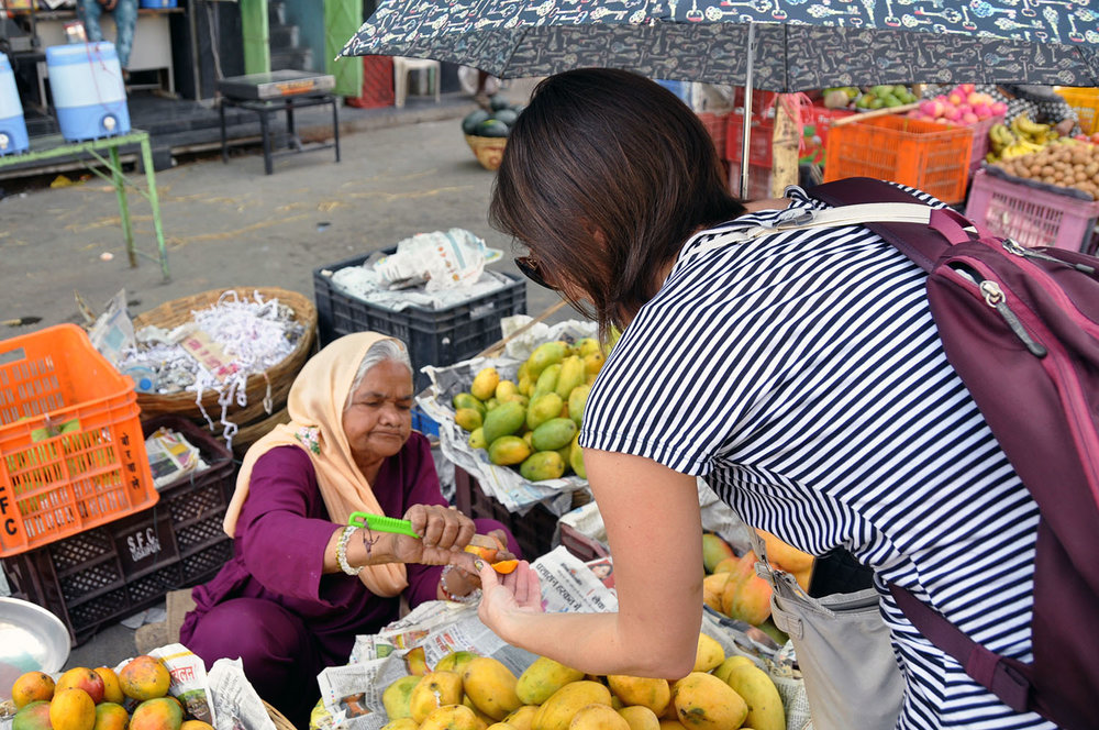 Shopping at a fruit market Cheap Travel Hacks