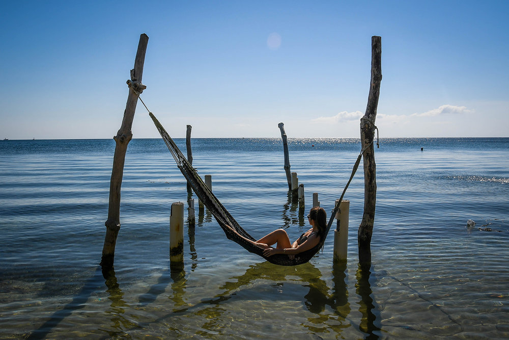 Roatan vs. Utila Honduras Bay Island Hammock over water