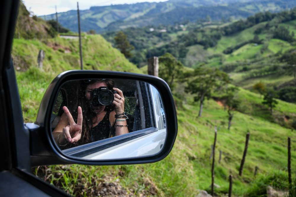 Renting a Car in Costa Rica Side mirror and countryside