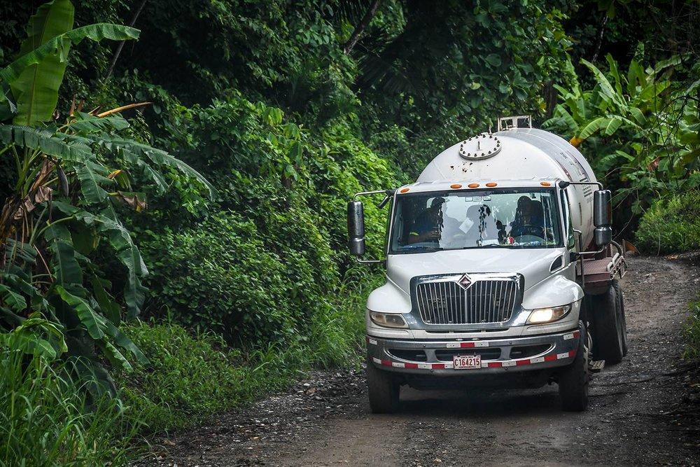 Renting a Car in Costa Rica Passing Semi Trucks