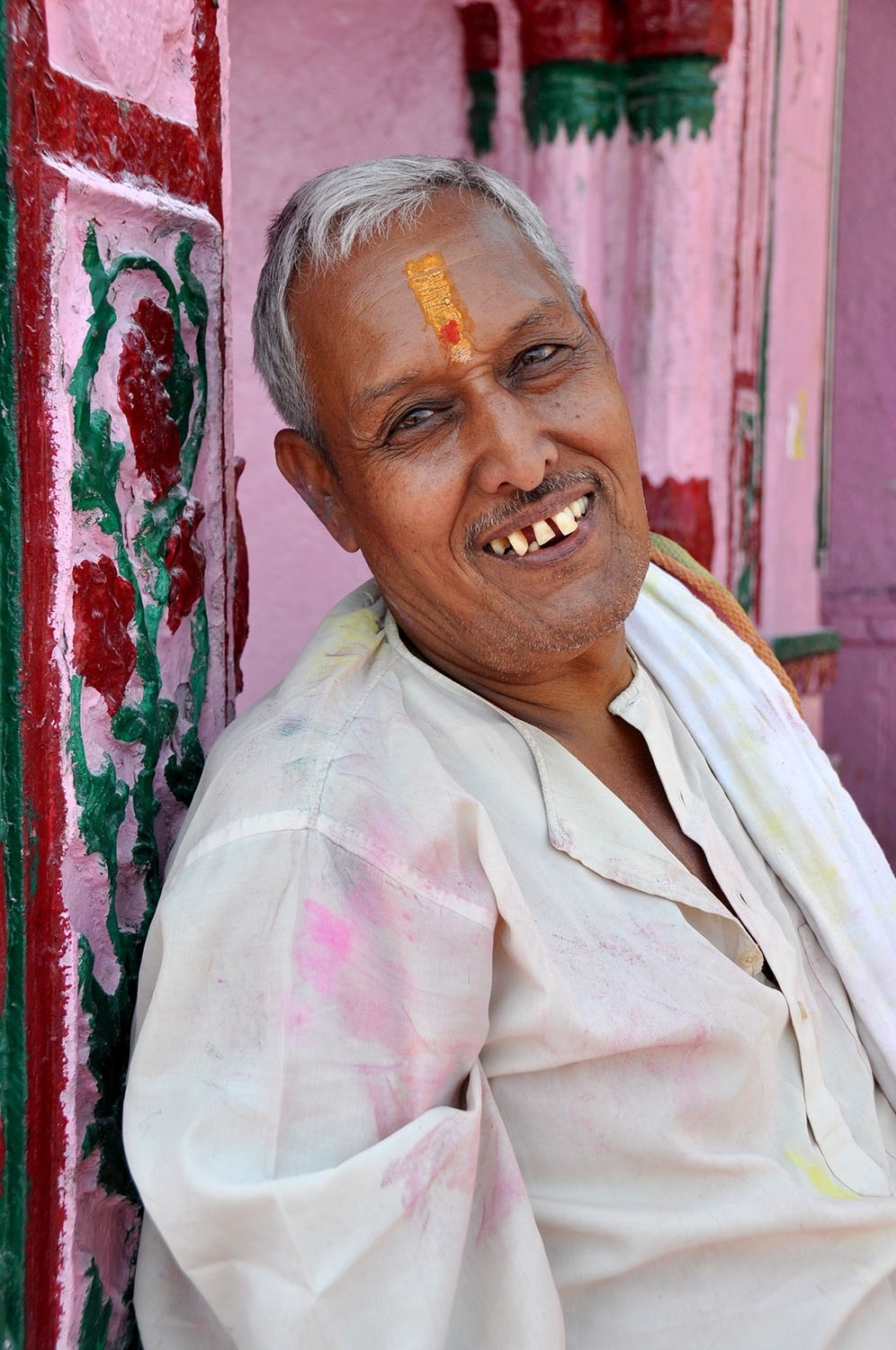 We sat down to take a break during the Holi Hai festivities in India, and had a wonderful conversation with this man. He wanted us to know that the message of Holi is to spread happiness throughout the world. He then asked if I could take a picture of him so I would remember his message. So sweet!