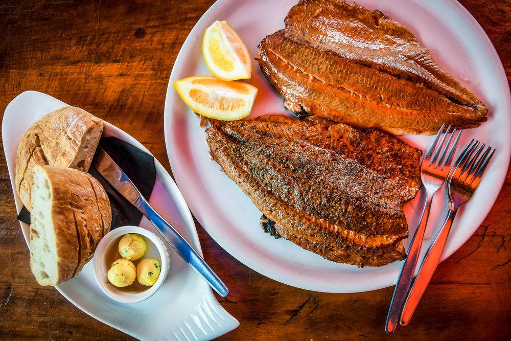South Island New Zealand Itinerary Anatoki Salmon Fishing cooked Salmon