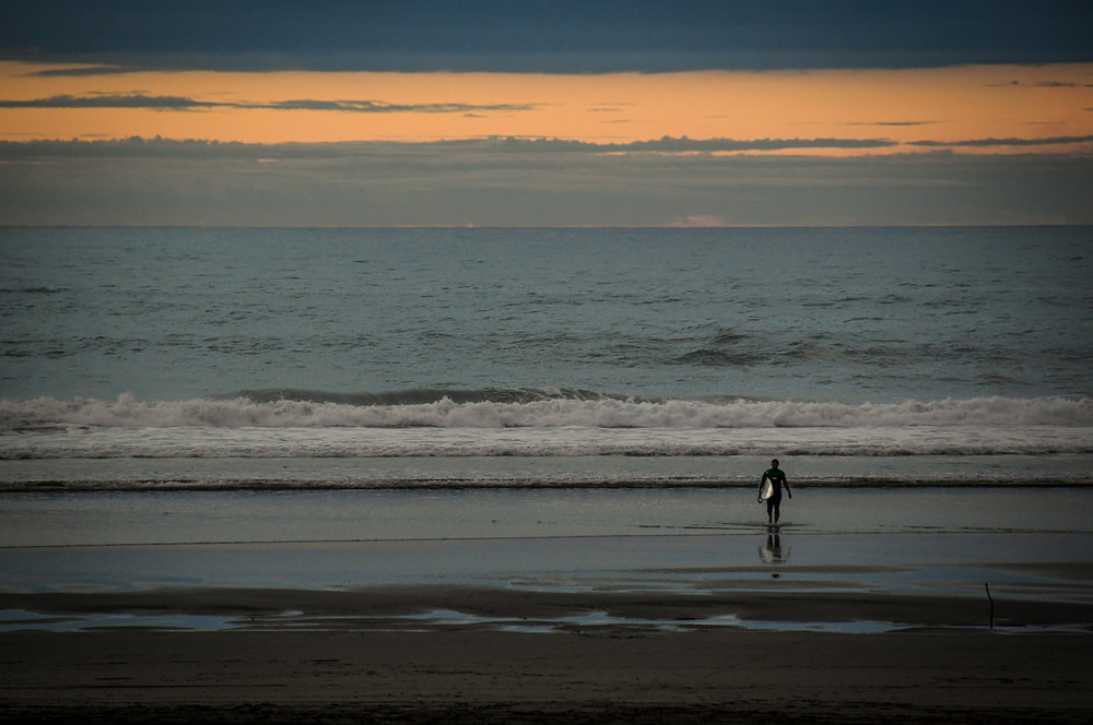 Things to do in Auckland Piha Beach Surfer