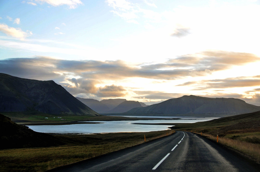 Rental Cars Iceland Open Highway Mountains and Water Iceland