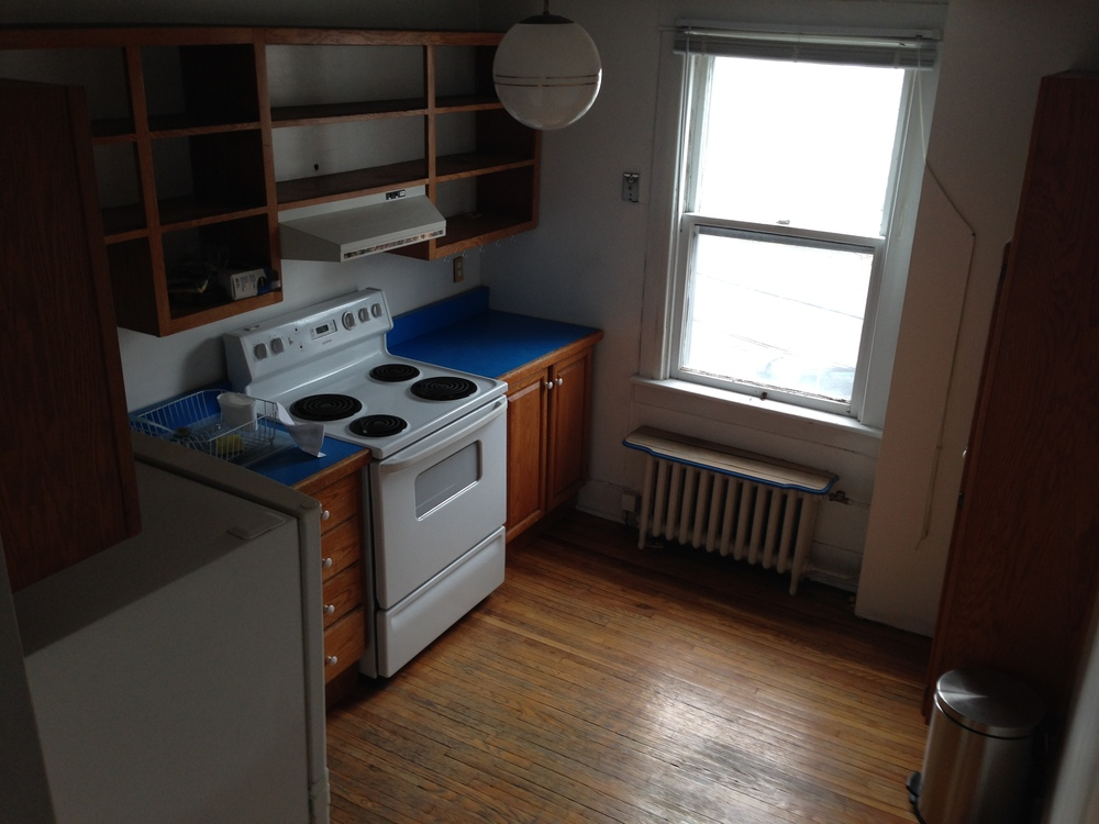 Very nice features in the second floor apartment.  Hardwood floors throughout though not original to the house.  The windows are all large and the light in here is quite beautiful.  I would have done anything for an apartment like this when I was  student!!
