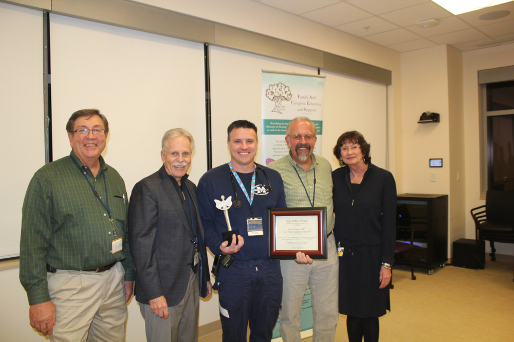 Greg is pictured with Ken Bandy-Senior Administrative Director at UofM Health System, Dr. Joe Custer. MD-Medical Director, Ron Dechert-Manager, Pediatric Respiratory Care and Sharman Lamka