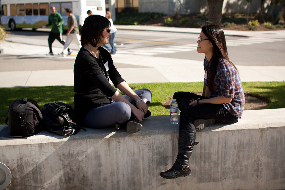 A recent study showed mentoring encourages college enrollment. Furthermore, in-person coaching seems to improve engagement and college persistence. - Photo: Flickr