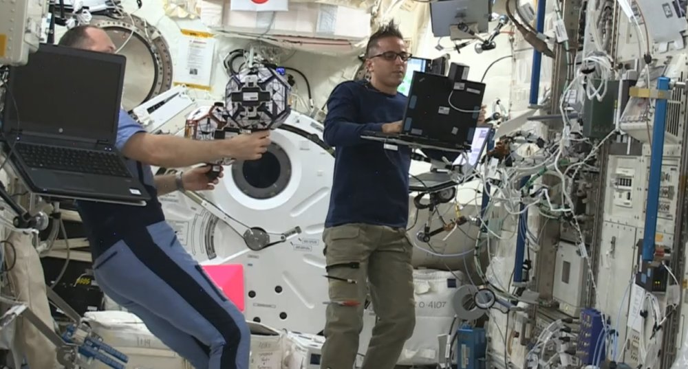 The experiment is carried in an ISS capsule, supervised by an astronaut.
