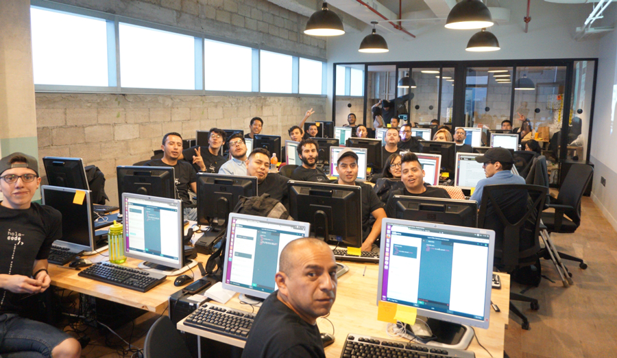 Hola Code is an intensive educational program that adopts and empowers Mexican immigrants to boost technological advancements in local companies. - Photo: holacode.com