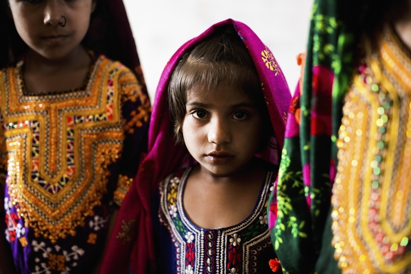 Four-year-old Benazir attends class with boys and girls of different ages in Haji Saleh Jat.