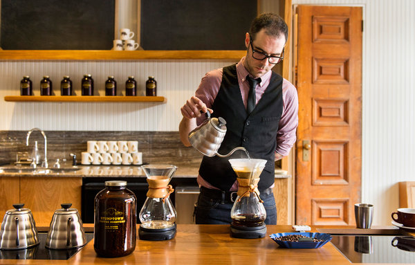 A hipster barista makes a potent brew.