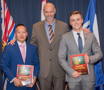 The NPESC Awards went to Jordan de Brouwer and Phillip Li, seen here receiving their books from Captain Ruether, the Secretary/Treasurer of the NPESC.