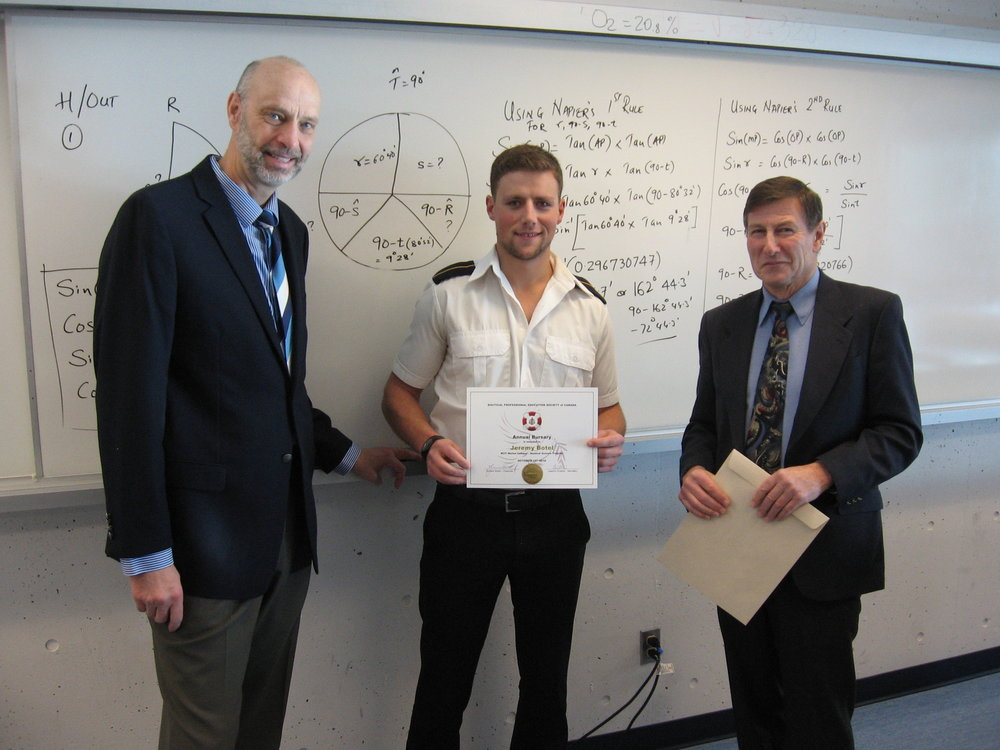 Cadet Jeremy Botel is presented with his certificate and bursary cheque by BC Supercargoes Association president Terry Stuart (right). Also in attendance is Captain Joachim Ruether, secretary/treasurer of NPESC.