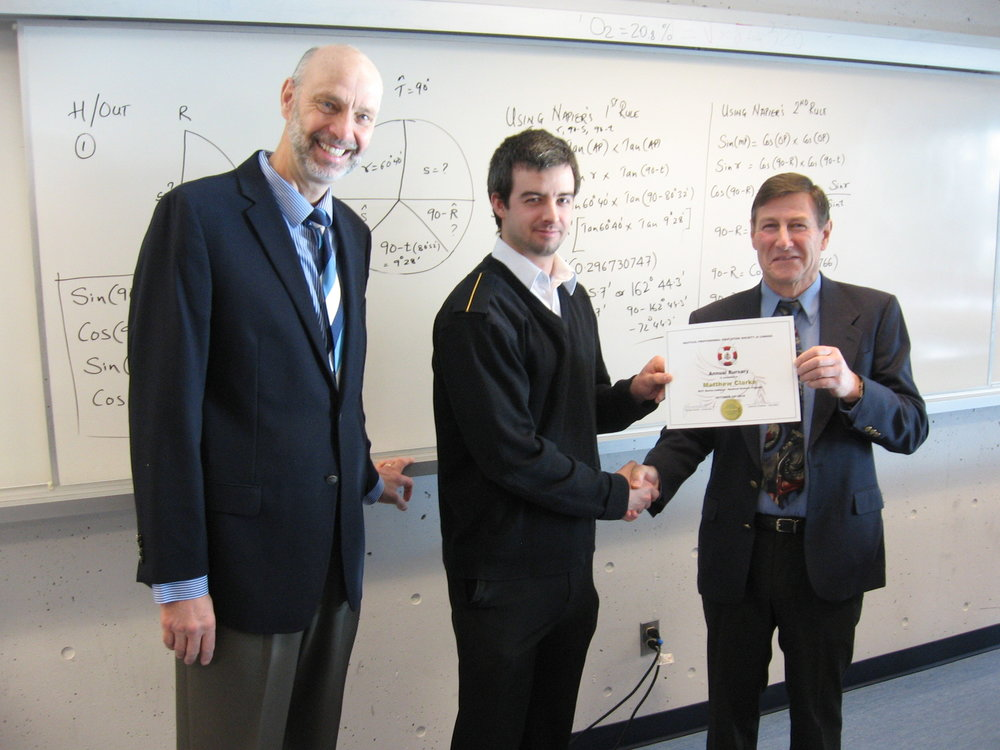 Cadet Matthew Clarke is presented with his certificate and bursary cheque by BC Supercargoes Association president Terry Stuart (right). Also in attendance is Captain Joachim Ruether, secretary/treasurer of NPESC.
