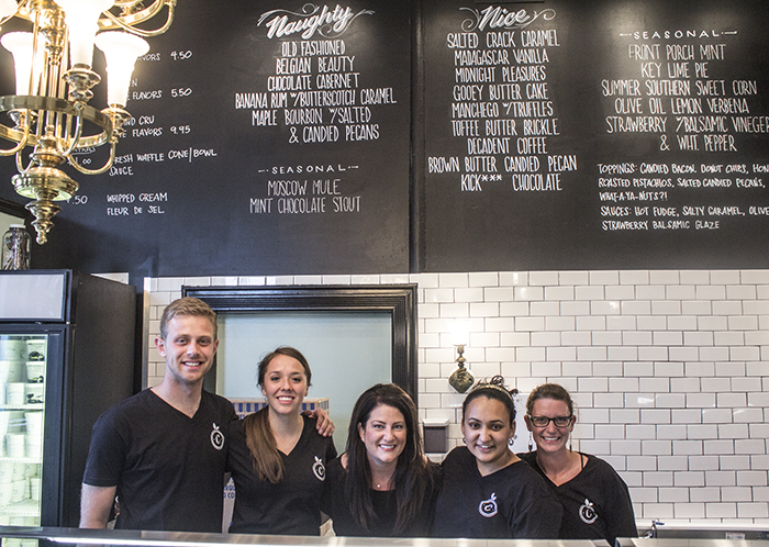 Tamara Keefe with her staff before a soft opening preview event.