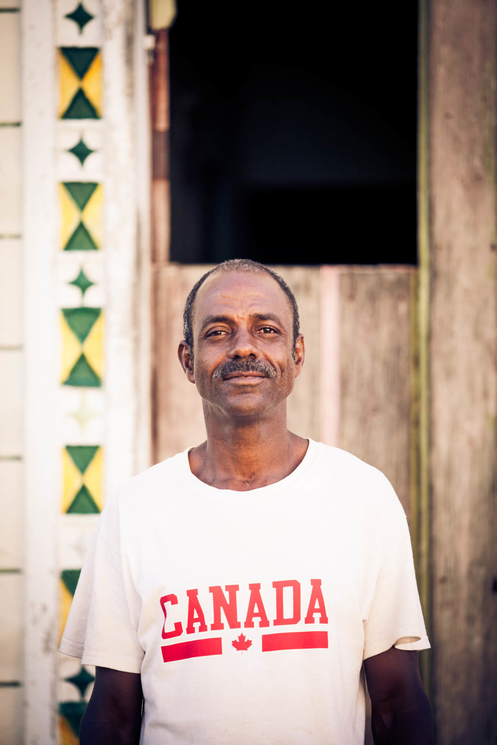 CANADA  We walked past this gentleman during the golden hour. He gave a friendly nod and asked if we'd take his photo. I held up my camera, I had 3 frames; this was one.