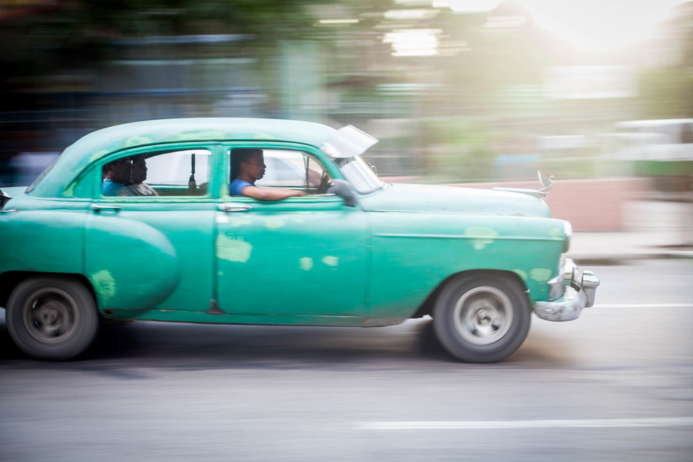 GREEN RIDER  Like a scene out of an old movie, a classic car races by in Havana.