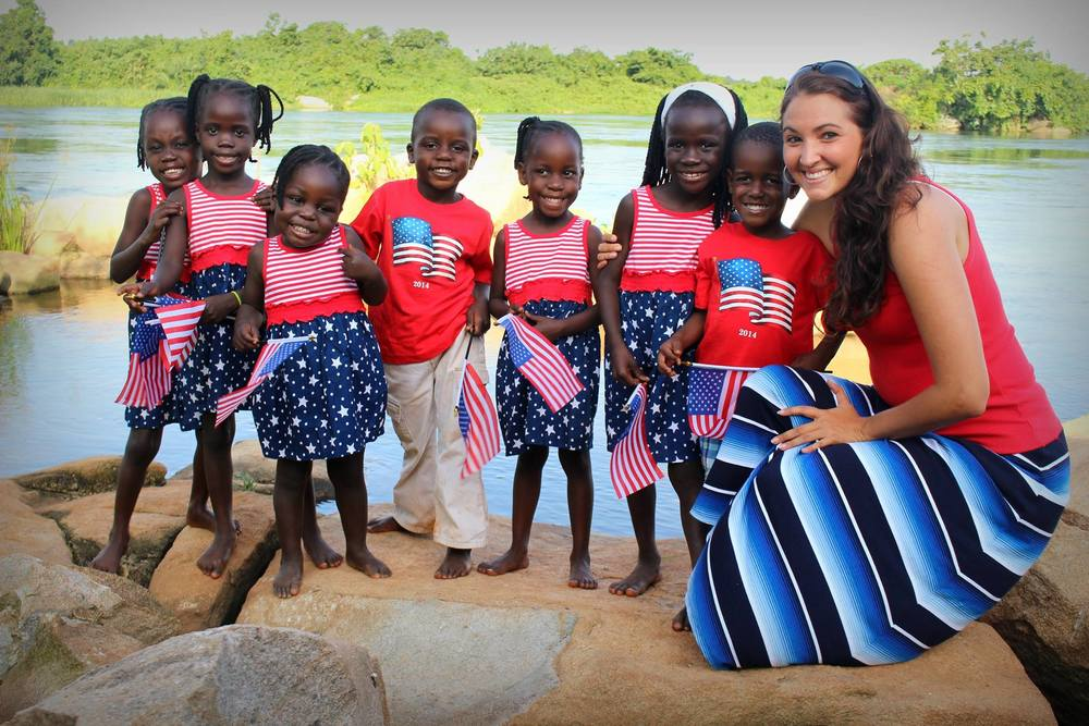 Amy with her seven adopted Ugandan children.